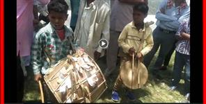 garhwali: Two boys of garhwal playing dhol damau