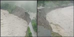 Black river flowing above danger mark in Pithoragarh